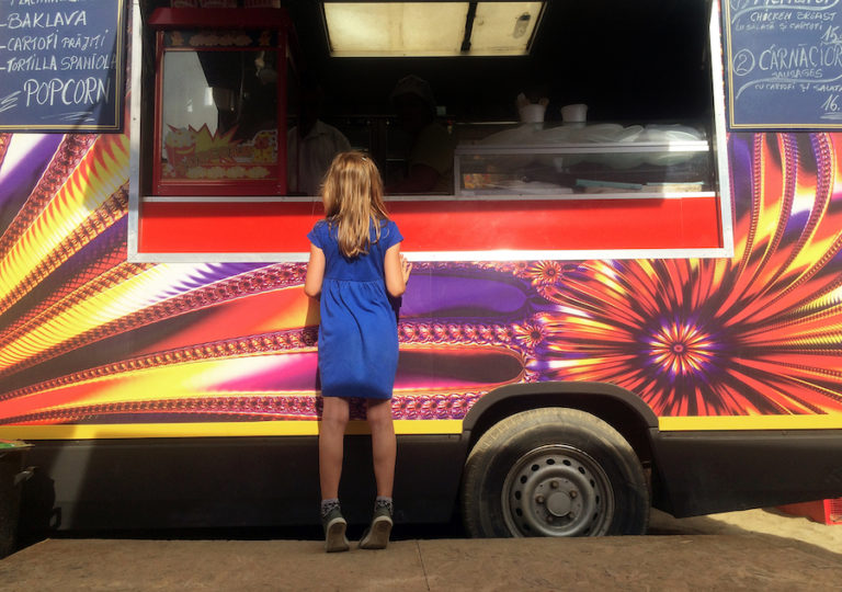 Girl in front of food truck
