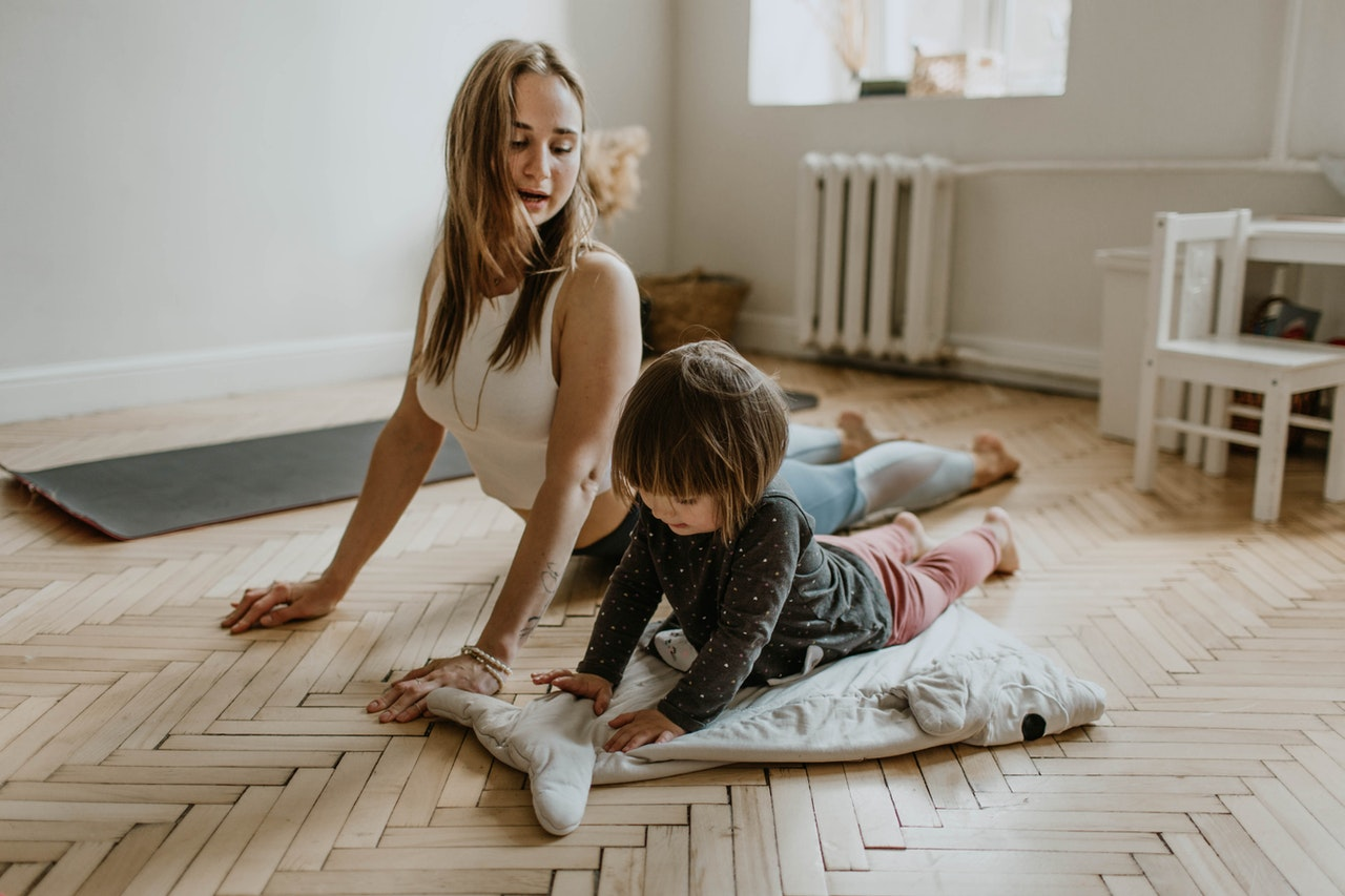 woman with daughter doing yoga