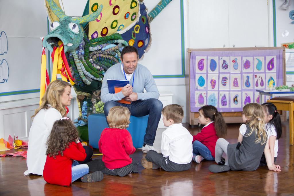 children gathered around a teacher