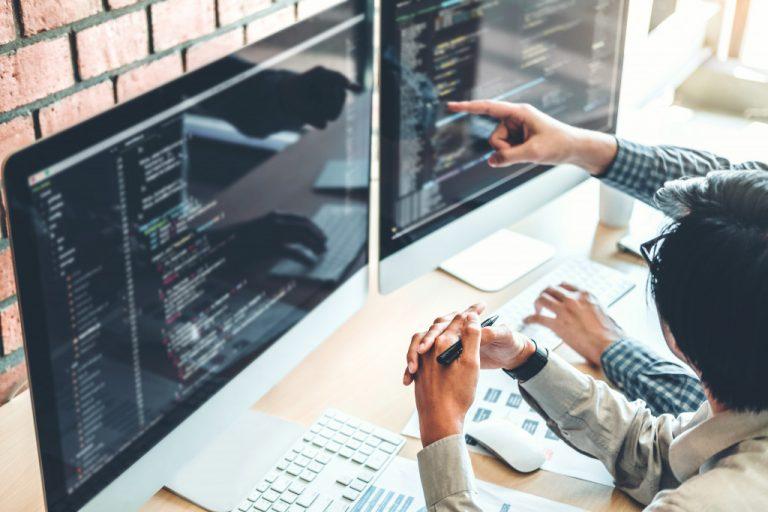 men writing code